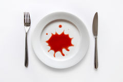 Red splatter on dish Stock Photography