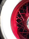Red Spokes. White wall tire on red spoked antique automobile rim stock photo