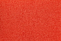 Red sponge texture. Red macro bubbly sponge texture background Royalty Free Stock Photo