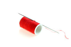 Red spool and needle Royalty Free Stock Images