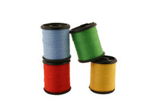 Red spool of thread Stock Photos