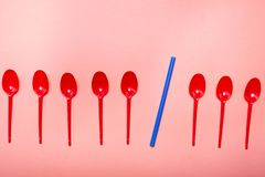 Red spoons on coral color background royalty free stock images