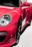 Red sport car. Headlamp of red sport car Royalty Free Stock Photo