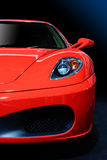Red Sport Car. Isolated on black and blue background Stock Photography