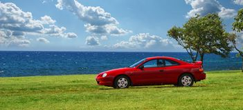 Red Sport Car. Parked on Fantastic Coast representing freedom of transportation Stock Photos