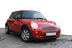 Red sport car. Red mini sport car parked isolated over white background Royalty Free Stock Image