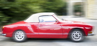 Red sport car. Red vintage sport car on the street Royalty Free Stock Photography