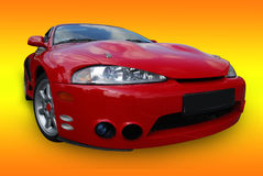 Red sport car (clipping path). Red sport car on orange background (isolated with clipping path Royalty Free Stock Image