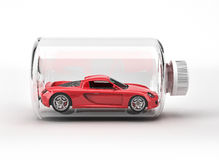 Red sport car closed inside a bottle. royalty free stock photography
