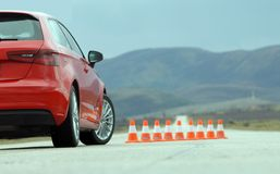 Red sport car and cones. On the test track Royalty Free Stock Image