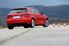 Red sport car and cones. On the test track Royalty Free Stock Images