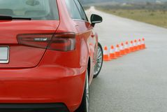 Red sport car and cones. On the test track Stock Photo