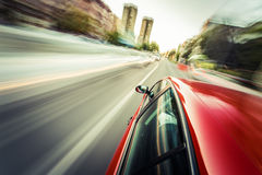 Red sport car driving during day Stock Image