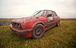Red sport car stay on the dirt Royalty Free Stock Images