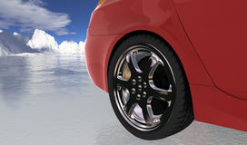 Red sport car on thin ice , rear wheel Royalty Free Stock Images