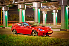 Red sport car. Under the brige with lights Stock Photos