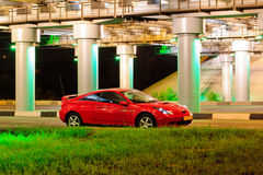 Red sport car. Under the brige with lights Stock Images