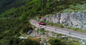Red sport convertible car moving in Amalfi coast stock video