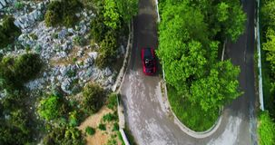 Red sport convertible car moving in Amalfi coast stock footage