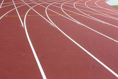Red sport track for running on stadium with white lines. Running healthy lifestyle concept. Sports background abstract royalty free stock photo