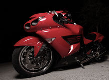 Red sports bike at night Stock Photo