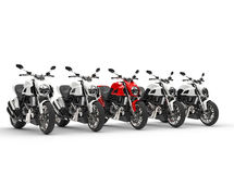 Red sports bike stands out amongs the white motorcycles Stock Photos