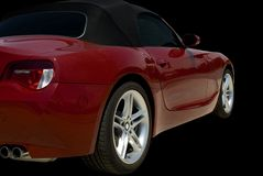 Red Sports Car. Red convertible sports car roadster  isolated on a black background. Clipping path included Royalty Free Stock Image