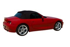 Red Sports Car. Red convertible sports car roadster  isolated on a white background. Clipping path included Royalty Free Stock Photography