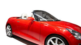 Red sports car. Displaying against white Stock Photos