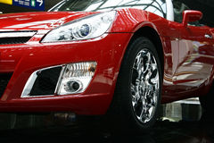 Red sports car. Close up of a latest red sports car Royalty Free Stock Photo