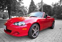 Red Sports Car. Parked on interlocking brick driveway stock photos