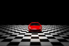Red Sports car. On a black background and checked floor Stock Photography