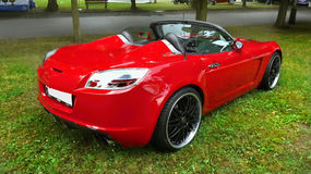 Red Sports Car. A red sports car - cabriolet. Rear side view Stock Photos