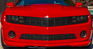 Red Sports Car (camarro). Red  sports car on wheels on Wyandotte Stock Photo