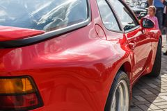 Red sports car coupe Porsche 944 at the city's Retro Car Show royalty free stock images