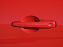 Red sports car door handle. Close up of Red sports car door handle Royalty Free Stock Images