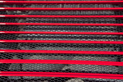 Red sports car engine grid. Detail of a luxury car Stock Photos