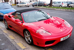 Red sports car ferrari convertible parking on road in France. Nice, France - September 15, 2007: Red sports car, ferrari convertible or cabriolet, modern luxury Royalty Free Stock Photo