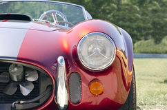 Red sports car front half ground view Stock Images