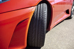 Red sports car front tyre Stock Photo