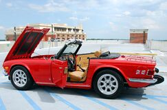 Red sports car on garage roof Stock Images