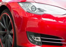 Red sports car headlight. Royalty Free Stock Photo