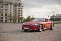 Red sports car. Red luxury sports car in the city Stock Image