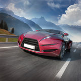 Red sports car moving on the mountain road. Original car design Royalty Free Stock Image