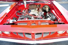 Red sports car open hood Stock Photo