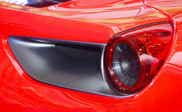 Red sports car rear light. Close-up view of red sports car rear light Royalty Free Stock Photos