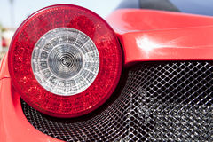 Red sports car spot light. Detail of a luxury car Stock Photography