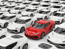 Red sports car stands out among white cars Stock Image