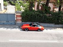 Red sports car on the street of a small Sicilian village royalty free stock photos