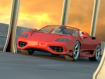 Red sports car in sunset Stock Image